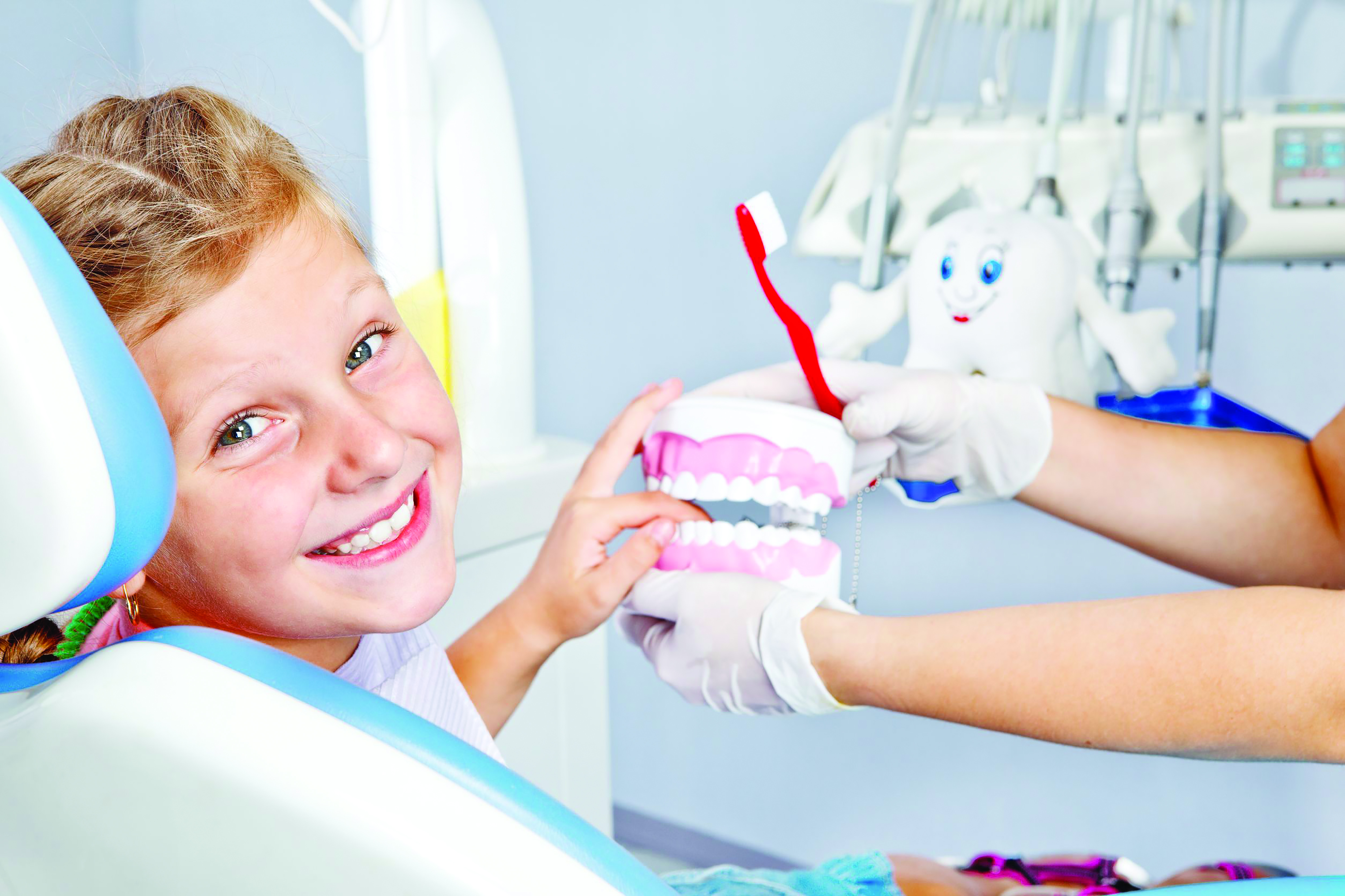 14632914 - happy child playing with toy dentures in dental office